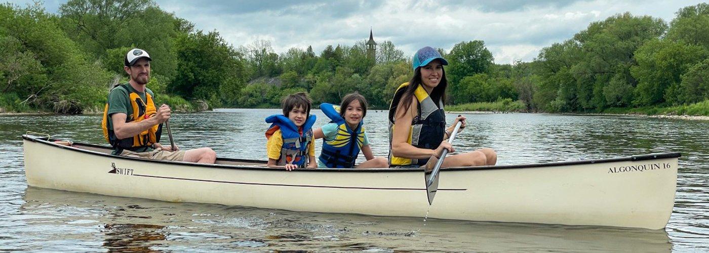 Family in canoe on river