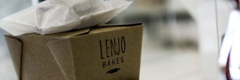 Photo of takeout boxes with LenJo Bakes logo stamped on them